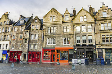 Brightly coloured shops and cobbled road at Grassmarket, Edinburgh